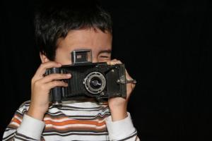 lil guy with Kodak Folding Brownie